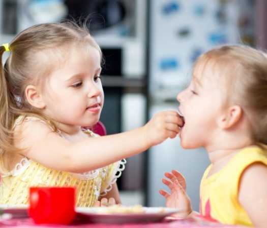 Two children sharing food while on low FODMAP diet
