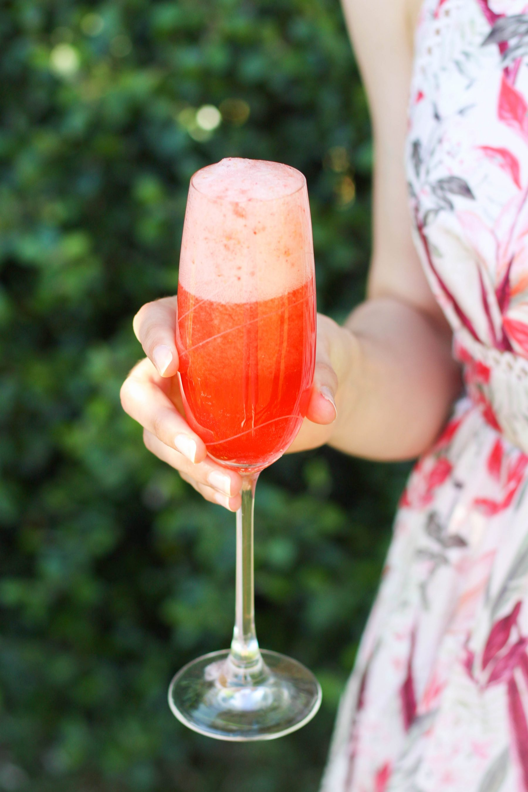 Woman holding low FODMAP strawberry mimosa-2