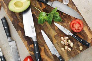 Sharp knives on cutting board