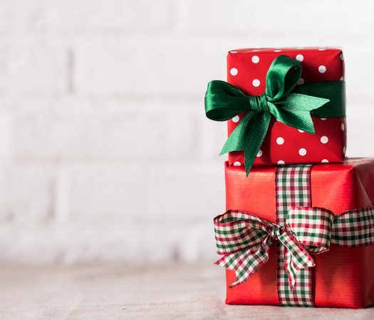Wrapped Low FODMAP Presents by a white brick wall