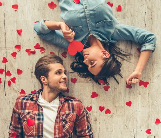 Young couple on low FODMAP date surrounded by hearts
