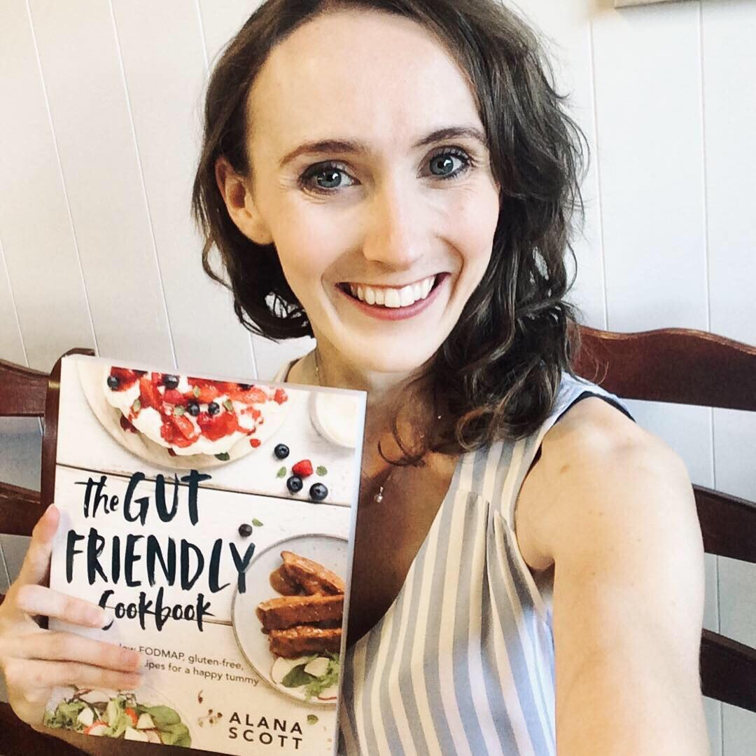Alana Scott holding The Gut Friendly Cookbook