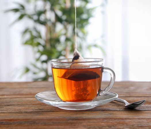 Low FODMAP Tea Brewing In Glass Mug
